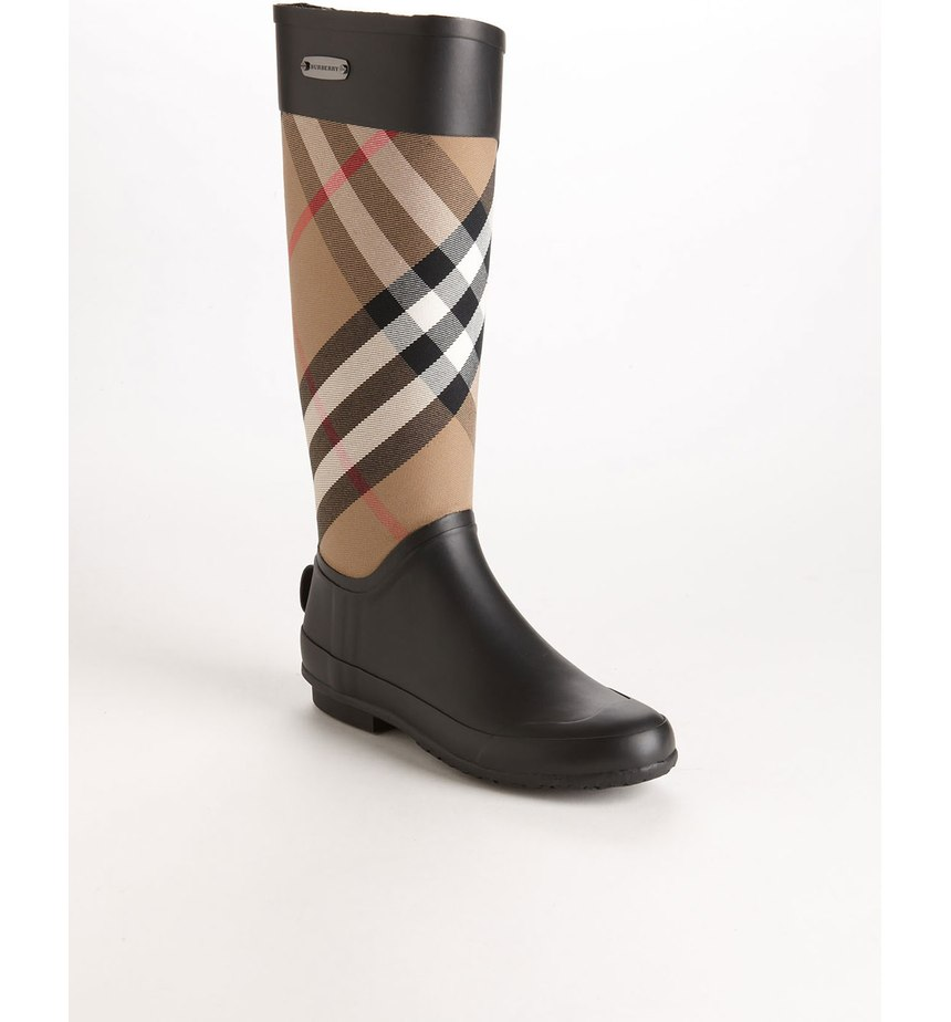 These Burberry boots are a total splurge, but they're never going out of style.  If you can swing it, they are a great staple for the Seattle girl.   (Image: Nordstrom)