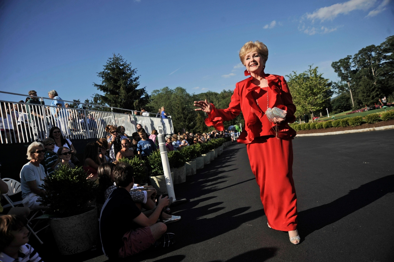 "FILE- In this July 2, 2010, file photo, actress Debbie Reynolds arrives at The Greenbrier for the gala opening of the Casino Club in White Sulphur Springs, W.Va. Reynolds, star of the 1952 classic ""Singin' in the Rain"" died Wednesday, Dec. 28, 2016, according to her son Todd Fisher. She was 84. (AP Photo/Jeff Gentner, File)"