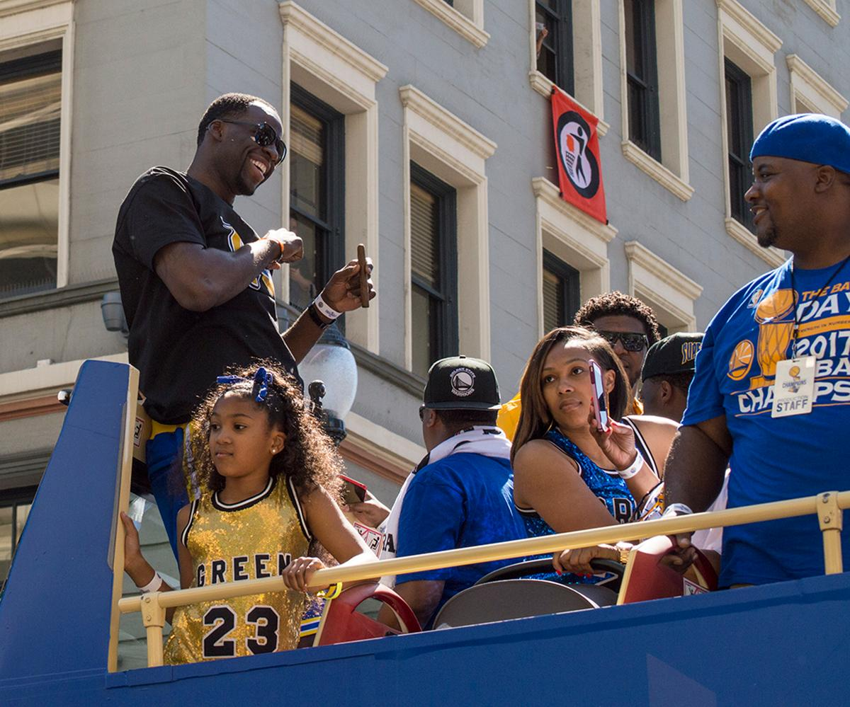 Draymond Green greets fans atop his double decker bus in the Golden State Warriors victory parade in Oakland, California. Photo by Emily Gonzalez, Oregon News Lab.