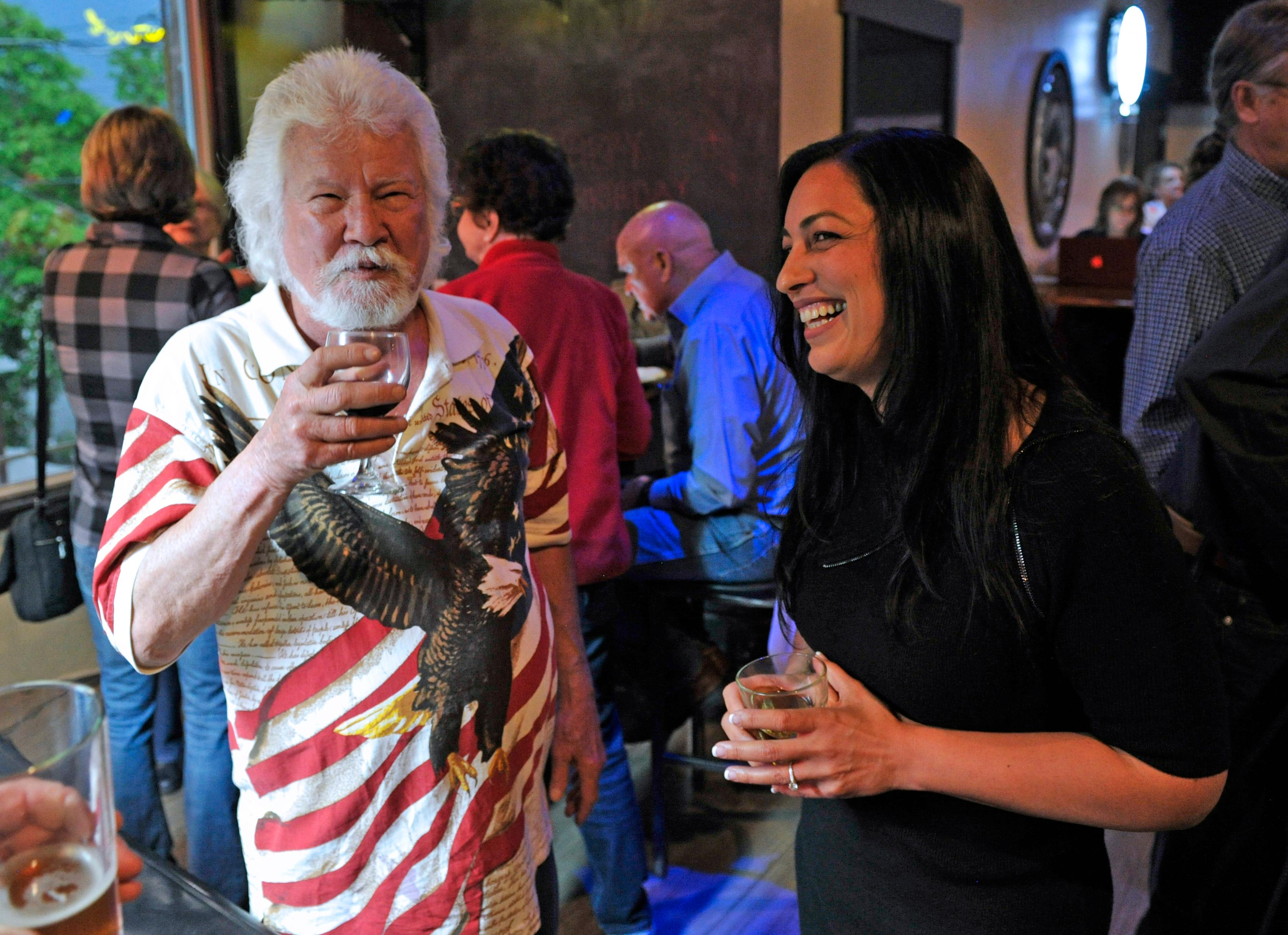 Jamie Lusch /Mail TribuneOregon Senate candidate Jessica Gomez talks with JD Jones of Central Point while waiting for results at Grape Street Bar & Grill Medford on Tuesday.