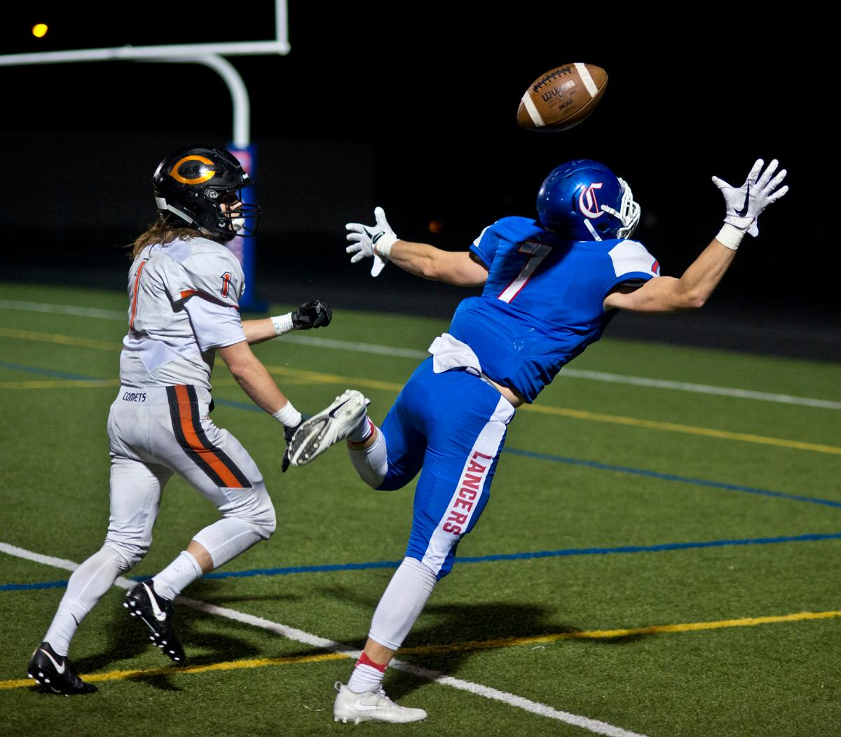 Churchill Lancers wide receiver Aidan Fox (#7) is unable to haul in a pass as Crater Comets defensive back Dylan Kinney (#1) is unable to break up the play. Churchill defeated Crater 63-21 on Friday at their homecoming game. Churchill remains undefeated with a conference record of 9-0. Photo by Dan Morrison, Oregon News Lab