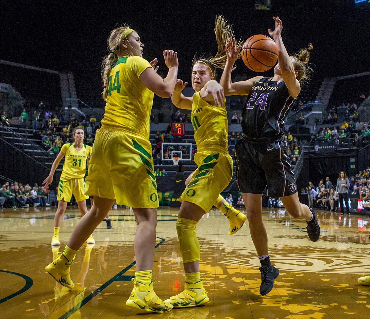Oregon Ducks Sabrina Ionescu (#20) fights for the ball. The Oregon Ducks defeated the Washington Huskies 94-83 on Sunday at Matthew Knight Arena. The victory was Head Coach Kelly Graves' 500th career win. Sabrina Ionescu also set the new NCAA all time record of 8 triple doubles in just 48 games. The previous record was 7 triple doubles in 124 games, held by Susie McConnell at Penn State. The Ducks will next face off against USC on Friday January 5th in Los Angeles. Photo by Rhianna Gelhart, Oregon News Lab