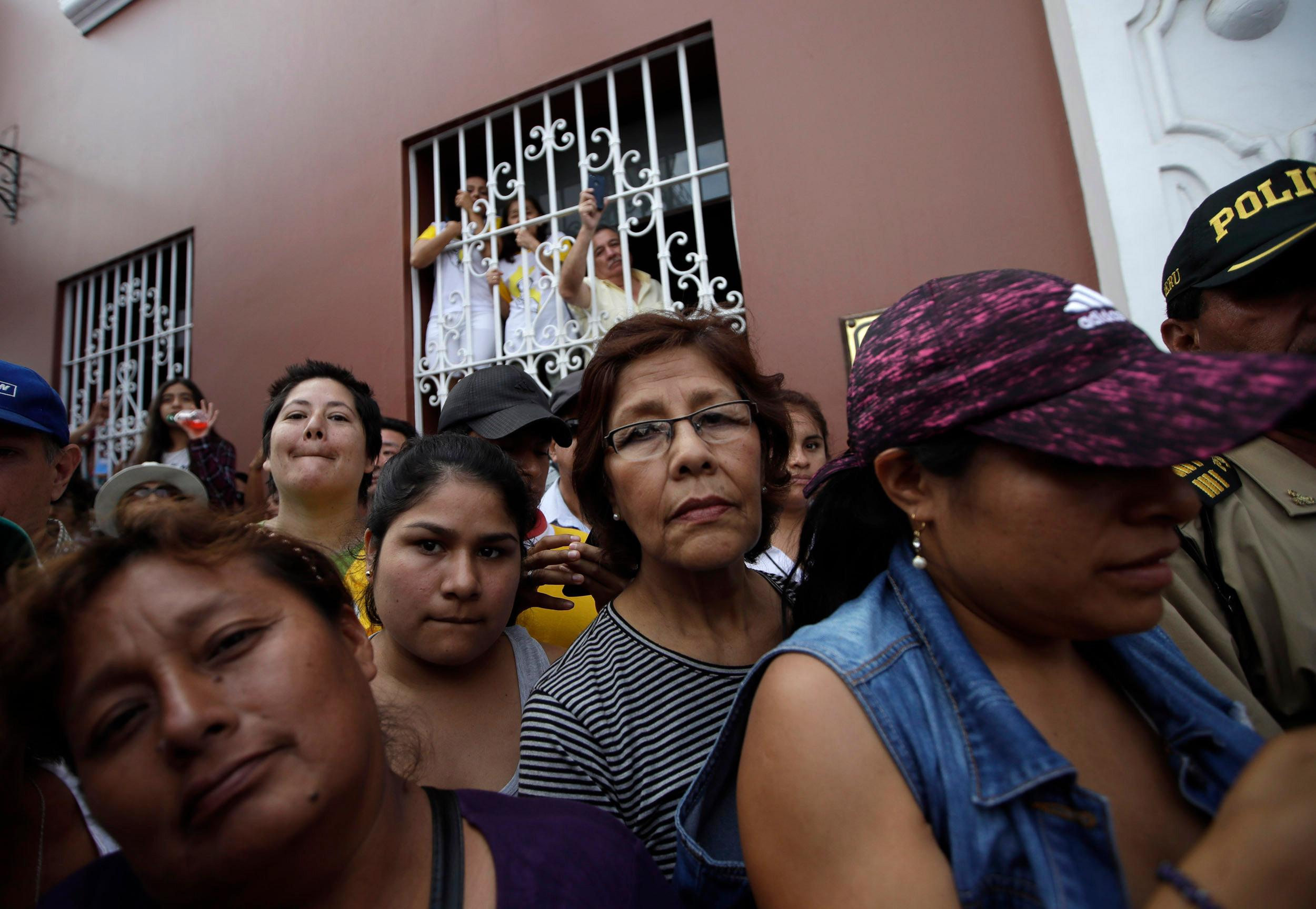 "A group of women try to get a glimpse of Pope Francis as he arrives for a Marian prayer celebrating the Virgin of La Puerta of Otuzco, at Plaza de Armas in Trujillo, Peru, Saturday, Jan. 20, 2018. Francis called women, mothers and grandmothers the guiding force for families. But he said women are nevertheless victims of ""femicide and many situations of violence that are kept quiet behind so many walls."" (AP Photo/Alessandra Tarantino)"