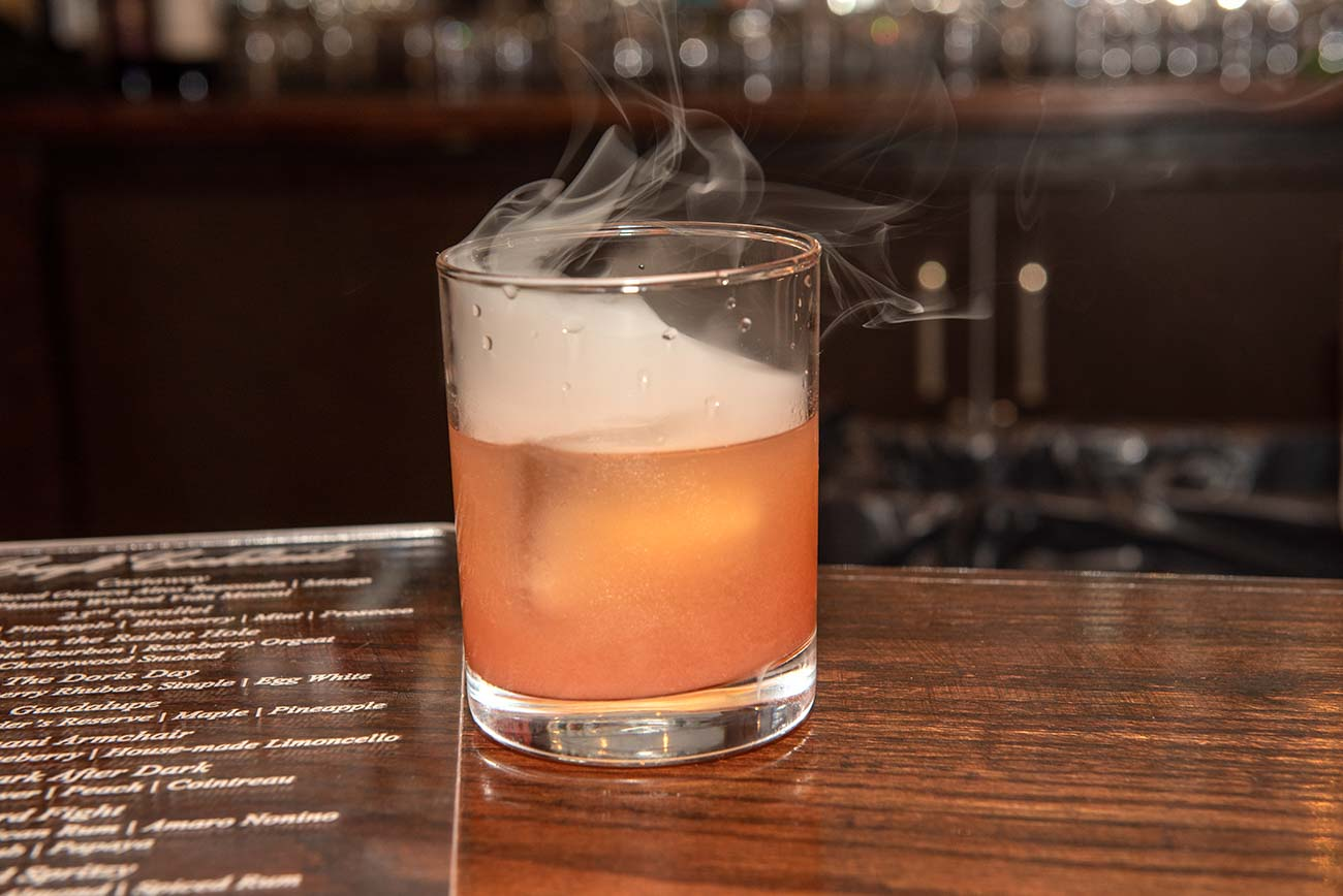 The Smoked Cocktail: Down The Rabbit Hole Bourbon, raspberry orgeat, and cherrywood smoke{ }/ Image: Joe Simon // Published: 6.25.20
