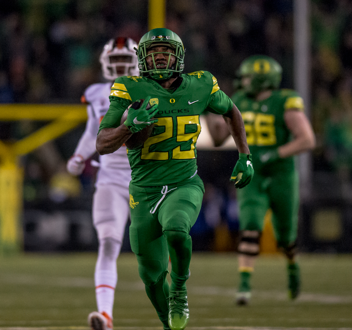 Oregon running back Kani Benoit (#29) runs the ball for a touchdown. The Oregon Ducks defeated the Oregon State Beavers 69 to 10 in the 121st Civil War game at Autzen Stadium in Eugene, Ore. on Saturday November 25, 2017. Photo by Ben Lonergan, Oregon News Lab