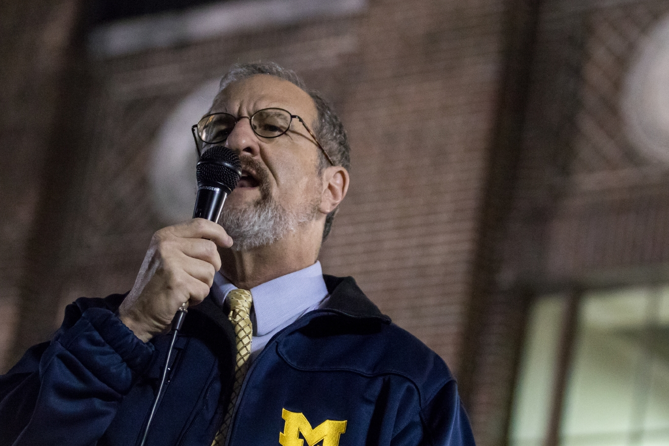 Mark Schlissel, University of Michigan President, speaks during a gathering of over 1,000 people on the University of Michigan's campus on Wednesday, Nov. 9, 2016. The gathering promoting love, equality, and surprise of the recent election of Donald Trump. (Matt Weigand/The Ann Arbor News via AP)
