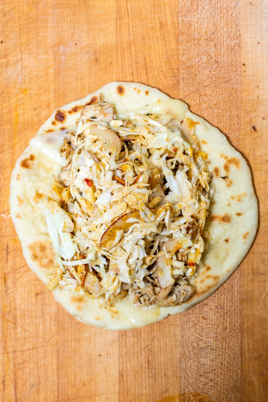 Ya Mon: jerk chicken breast, coconut-apple slaw, and Havarti cheese on a fresh pita / Image: Amy Elisabeth Spasoff // Published: 9.29.18
