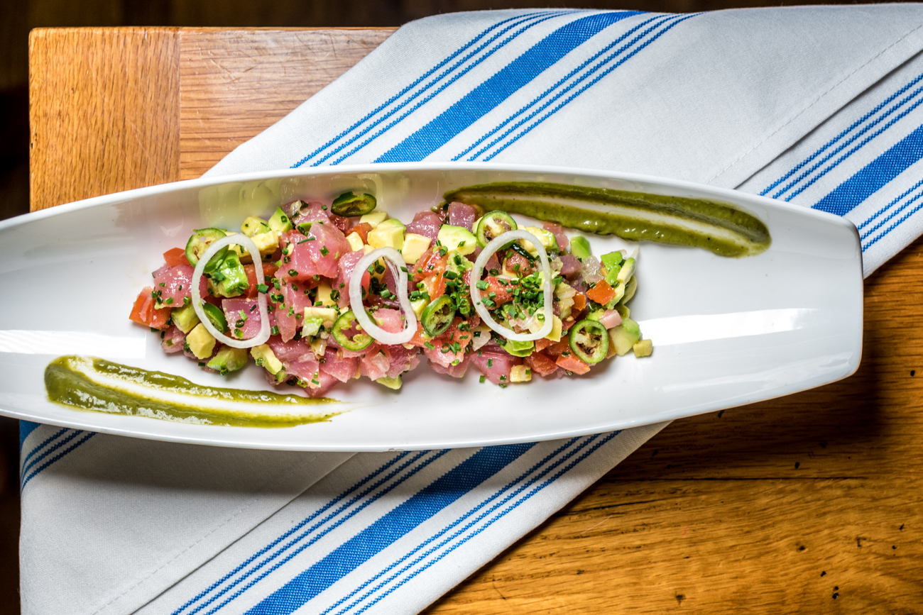 Yellow Fin Tuna Crudo: tomatoes, shallots, avocado, citrus and serrano peppers / Image: Catherine Viox // Published: 1.23.20