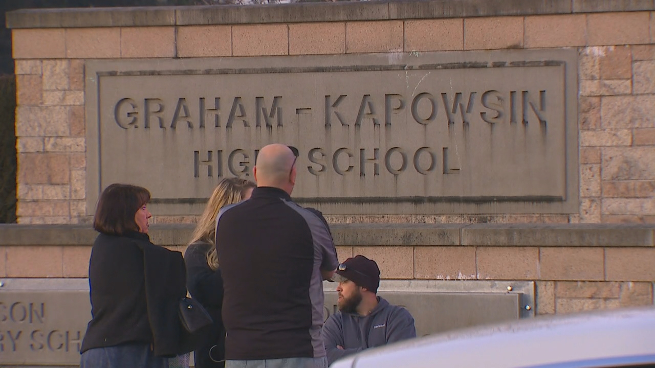 Law enforcement personnel respond to a shooting outside Graham-Kapowsin High School. (KOMO News file photo)