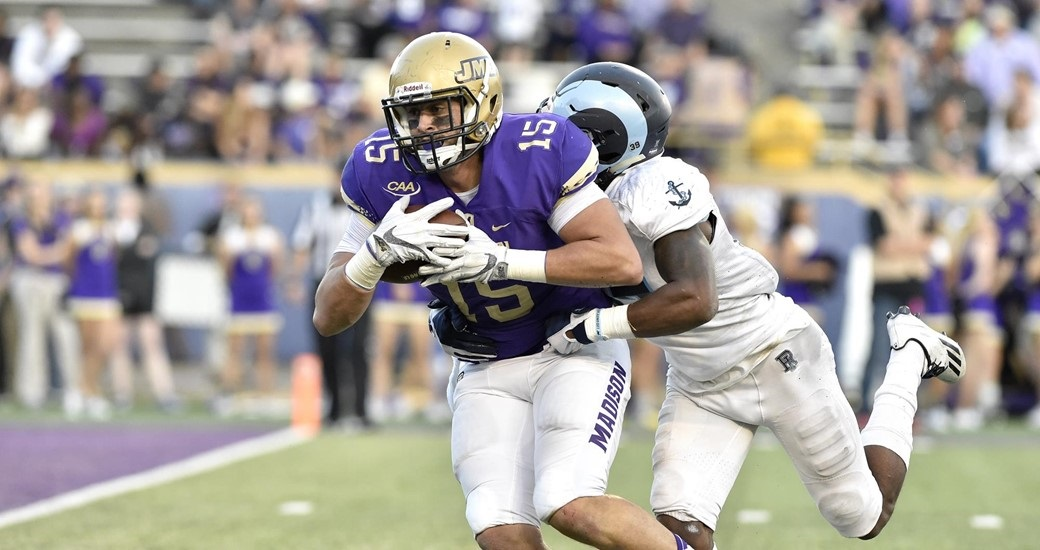 JMU 84, RHODE ISLAND 7: The eighth-ranked Dukes (7-1) scored 80 points for the second time this season, setting school and CAA Football records for points and margin of victory. Bryan Schor also set JMU's single-game completion percentage record, completing 21 of 22 passes for 309 yards and 5 TDs — 3 to TE Daniel Schiele (15). (Photo courtesy JMU Athletics)