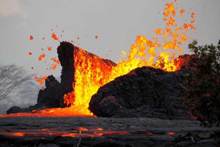 FILE - In this May 23, 2018 photo, lava erupts in the air in Leilani Estates area near Pahoa, Hawaii. (George F. Lee/Honolulu Star-Advertiser via AP)