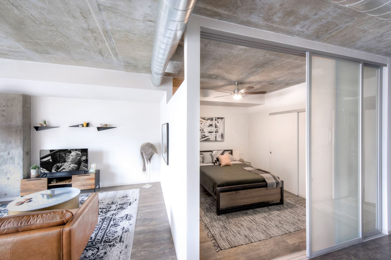 "Nestled in the heart of NoMa and just one block from the NoMa-Gallaudet metro stop on the red line, this new urban-inspired apartment building is just begging for millennial residents! Ranging from studios starting at $1,810 to three-bedrooms priced at $4,190,  AVA NoMa puts great emphasis on the ""social features"" of the complex. Seriously, there is 20,600 square feet of indoor/outdoor amenity space-- think a rooftop ""chill space"" with an infinity edge pool, a 4,800-square-foot indoor/outdoor fitness center with its own yoga/spin studio, communal fire pits, a pet spa, private work stations ideal for studying or working remotely and a Transit Screen in the lobby which displays real-time transit information.  Of course shared spaces are all well and good, but what about the in-apartment amenities? Personally, we can't stop obsessing over the quartz-stone countertops and tile backsplashes in the kitchen, the natural textures used as accent pieces in the design, the concrete columns and ceilings with exposed ductwork everywhere and especially the HUGE walk-in closets and the sliding barn door/chalkboard wall options! When can we move in?? Tour the rest of the apartment in our gallery and visit avaloncommunities.com for more info on the property. (Image: AvalonBay Communities, Inc.)"