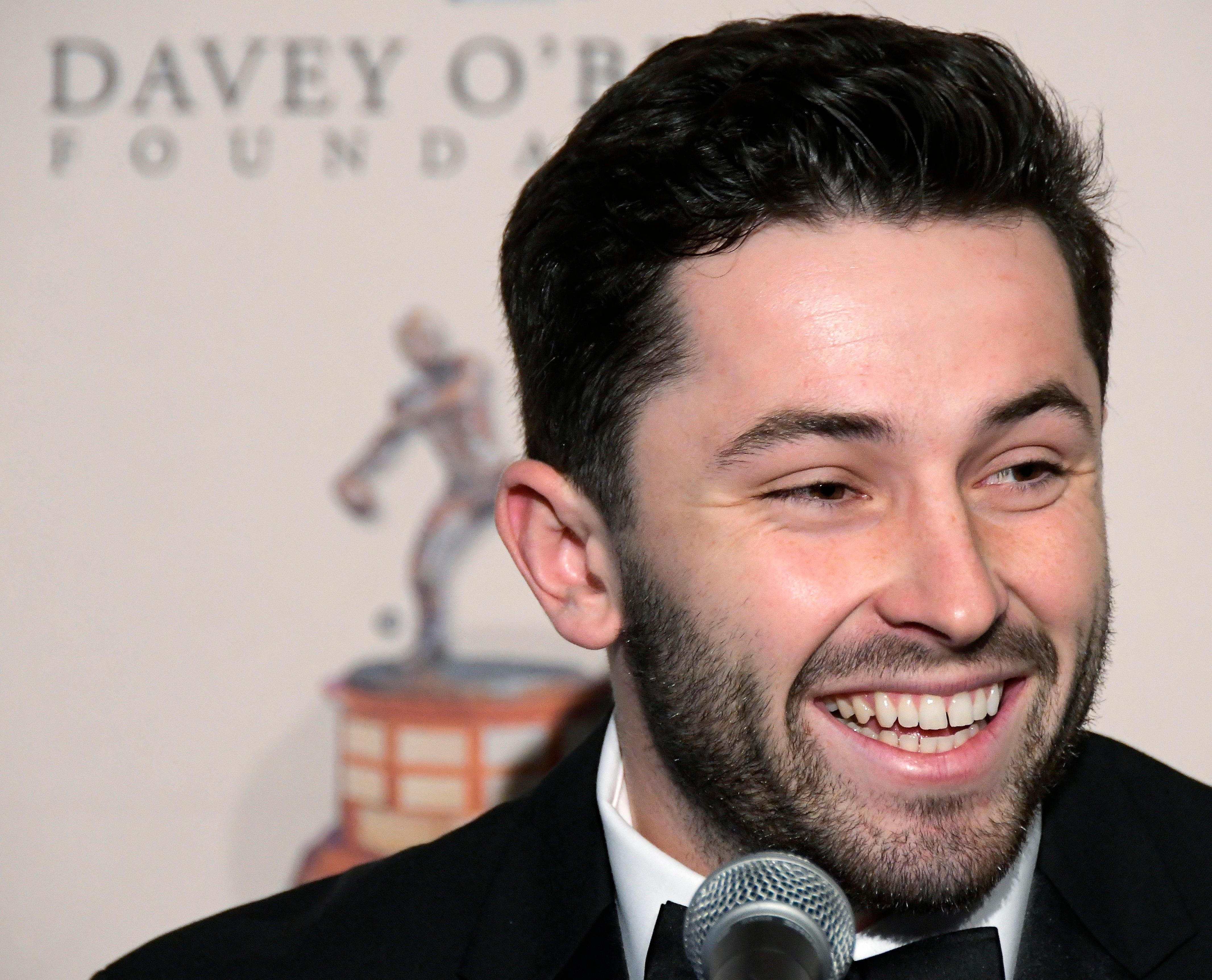 The Davey O'Brien National Quarterback Award winner Baker Mayfield smiles during a news conference at the Fort Worth Club in Fort Worth, Texas, Monday, Feb. 19, 2018. (Max Faulkner/Star-Telegram via AP)
