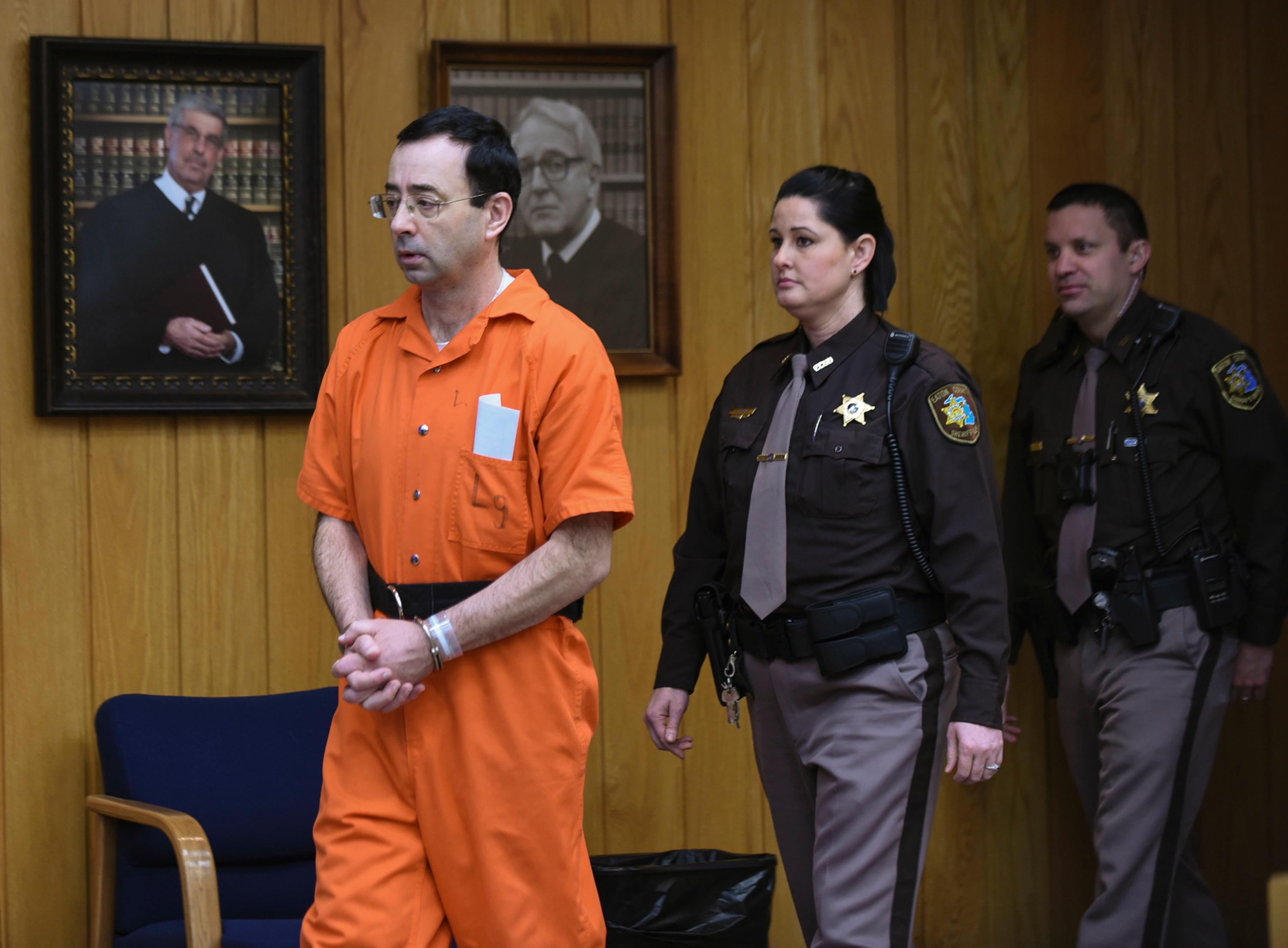 Larry Nassar enters Judge Janice Cunningham's circuit courtroom Wednesday, Jan. 31, 2018, during the first day of victim impact statements in Eaton County Circuit Court in Charlotte, Mich., where Nassar is expected to be sentenced on three counts of sexual assault some time next week. Nassar was sentenced to 40 to 175 years in prison in a similar hearing in another county last week. (Matthew Dae Smith/Lansing State Journal via AP)
