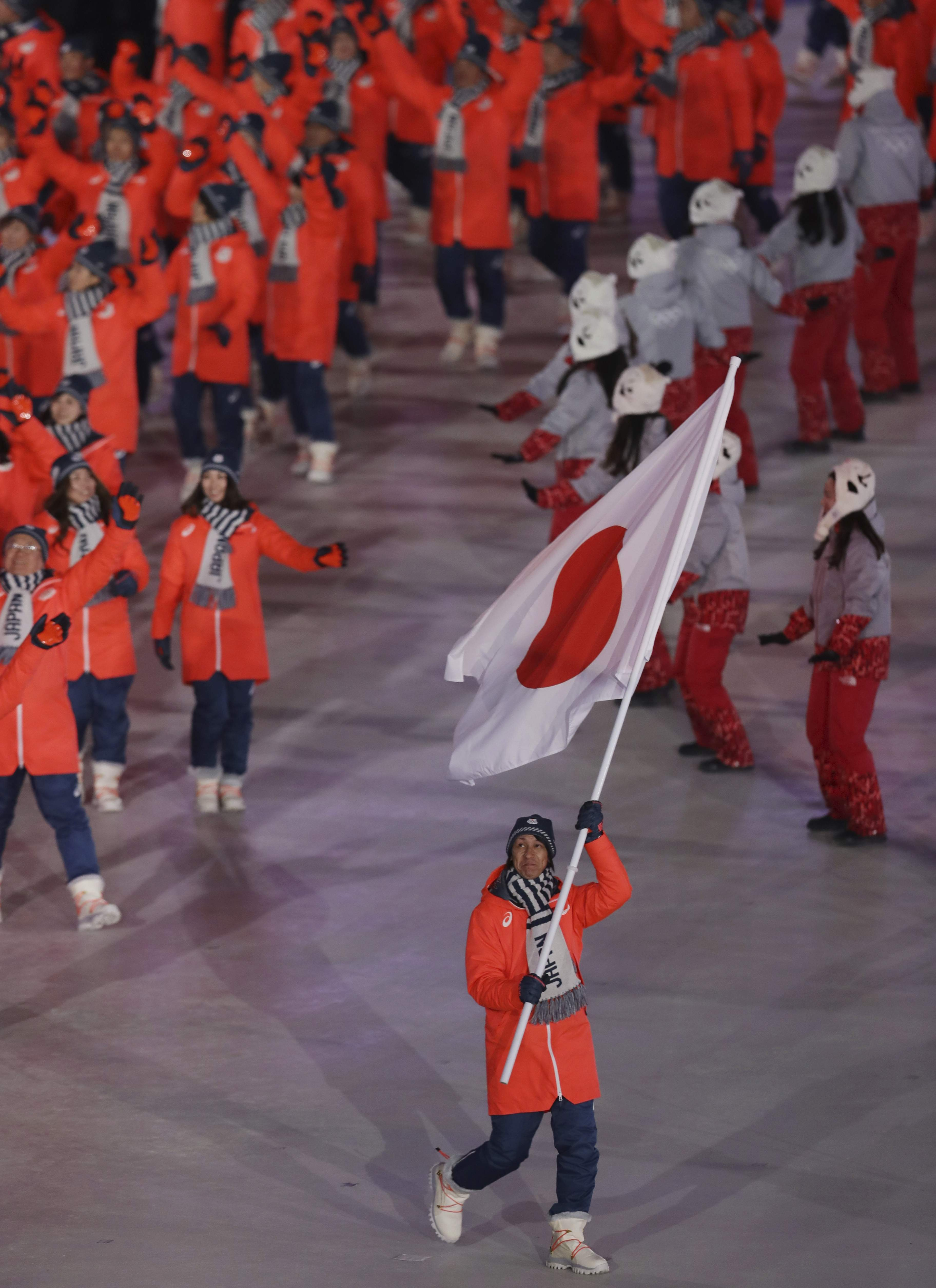Noriaki Kasai carries the flag of Japan during the opening ceremony of the 2018 Winter Olympics in Pyeongchang, South Korea, Friday, Feb. 9, 2018. (AP Photo/Michael Sohn)