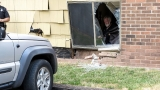Jeep crashes into Holley apartment building, damages unit