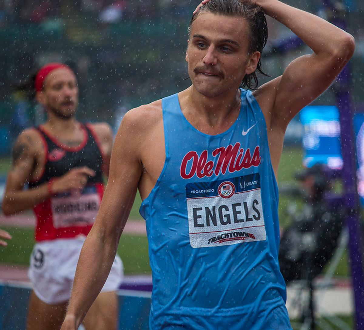 Ole Miss Rebel Craig Engels wipes the rain from his face as he crosses the finish line of the men�s 1,500 meter run semis. Day Eight of the U.S. Olympic Trials Track and Field continued on Friday at Hayward Field in Eugene, Ore. and will continue through July 10. Photo by Katie Pietzold