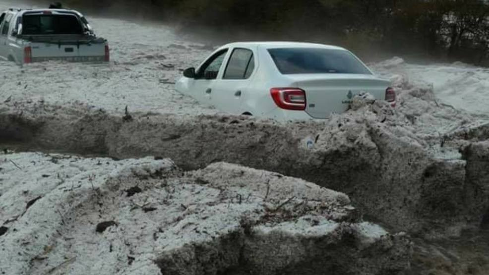 Massive storms in Argentina buries cars feet deep in hail