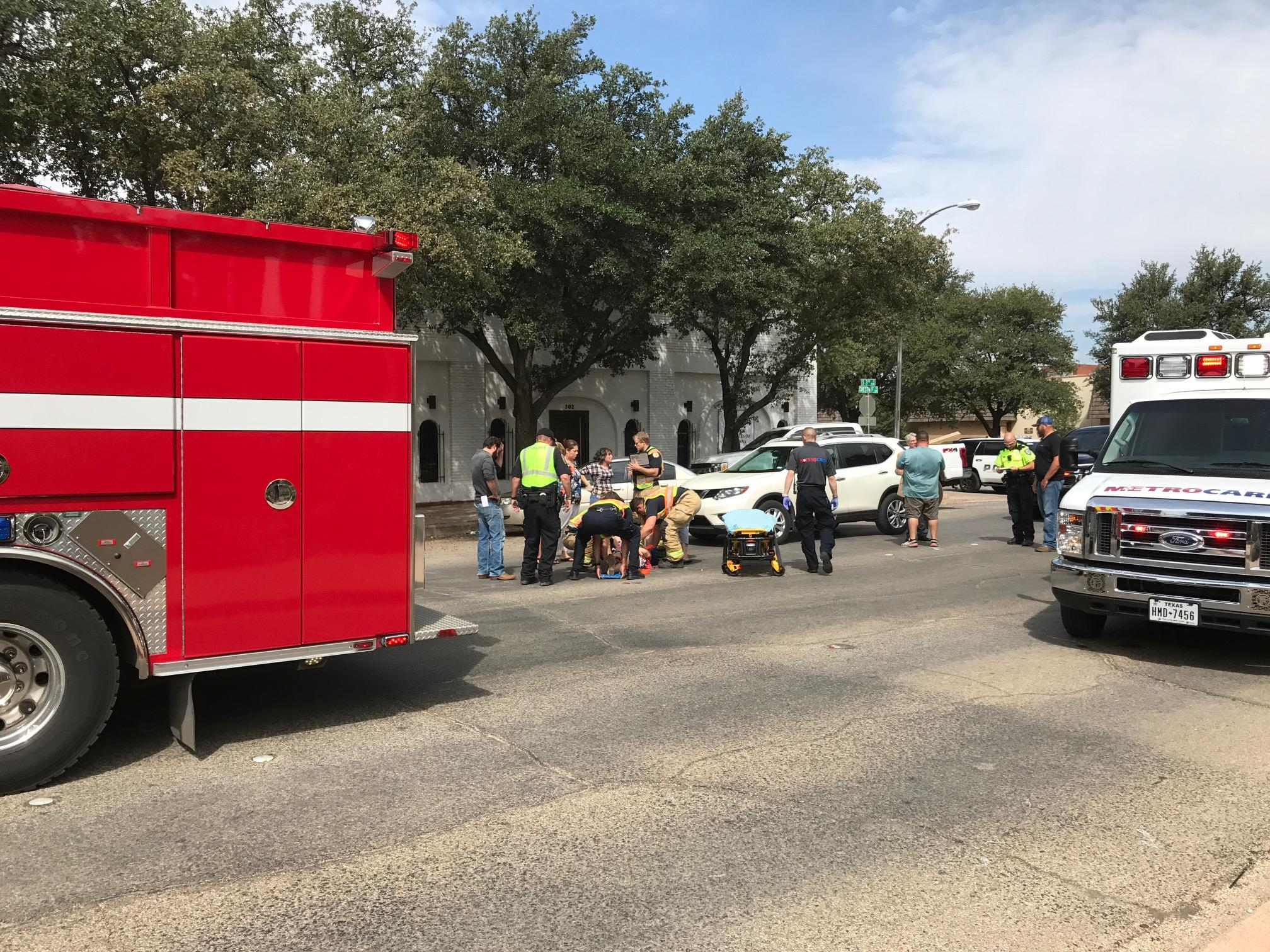 Photos by Scott Martin/KTXS News:  A 32-year-old woman crossing Chestnut Street near the Taylor County Courthouse was struck by a vehicle before noon Tuesday and had to be taken to Hendrick Medical Center. She was able to speak with paramedics and had what appeared to be non-life threatening injuries, according to Abilene police.