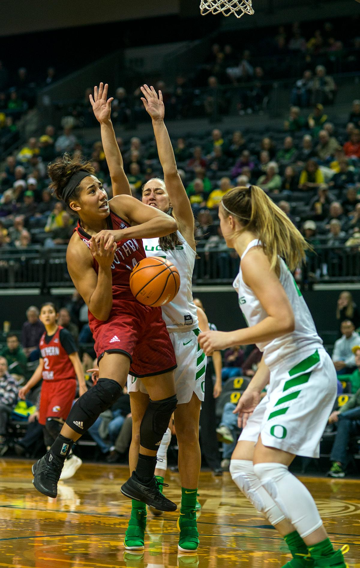 Southern Utah Thunderbirds Breanu Reid (#14) attempts to make it to the basket. The University of Oregon Ducks women basketball team defeated the Southern Utah Thunderbirds 98-38 in Matthew Knight Arena Saturday afternoon. The Ducks had four players in double-digits: Ruthy Hebard with 13; Mallory McGwire with 10; Lexi Bando with 17 which included four three-pointers; and Sabrina Ionescu with 16 points. The Ducks overwhelmed the Thunderbirds, shooting 50% in field goals to South Utah's 26.8%, 53.8% in three-pointers to 12.5%, and 85.7% in free throws to 50%. The Ducks, with an overall record of 8-1, and coming into this game ranked 9th, will play their next home game against Ole Miss on December 17. Photo by Rhianna Gelhart, Oregon News Lab