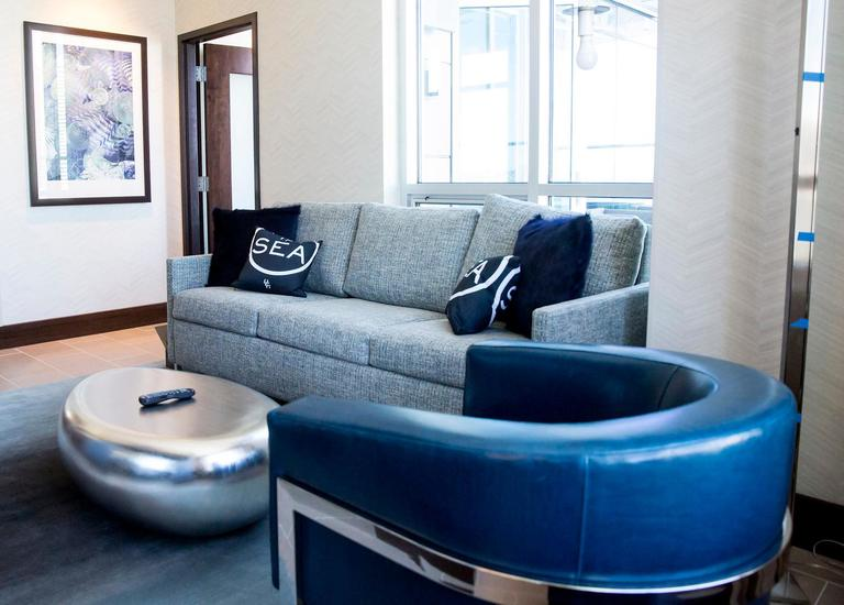 The Embassy Suites is opening their Seattle flagship at 225 King Street later this month and we got to take a sneak peek tour! The hotel boats panoramic views of Seattle and Elliot Bay and has 17 different rooms styles including premium and penthouse suites, two-bedroom guest rooms complete with living area, private bedroom and mini-kitchen. They will also open a bar in the lobby called Zephyr Bar, which will focus on flavors of the Northwest. (Sy Bean / Seattle Refined)