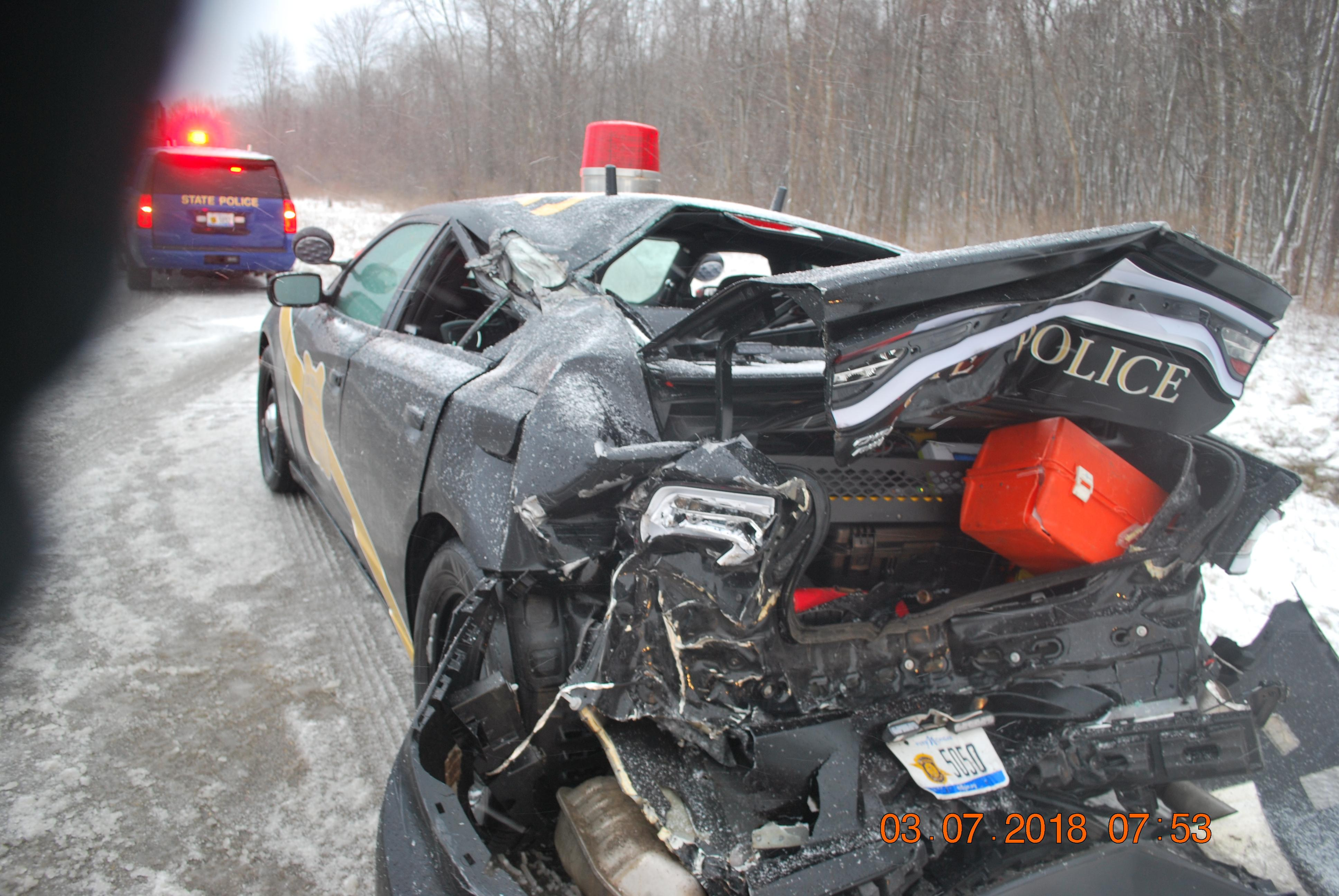 A Michigan State Police trooper was injured in a crash involving a semi Wednesday morning in Berrien County. (Courtesy: Michigan State Police)