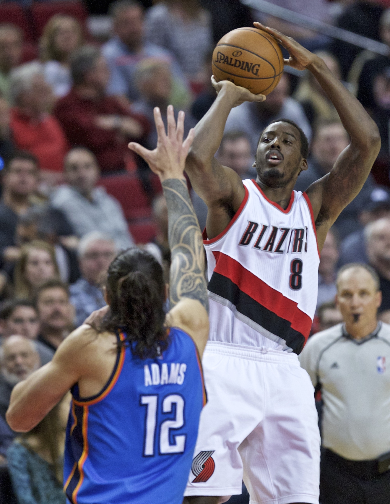 Portland Trail Blazers forward Al-Farouq Aminu shoots over Oklahoma City Thunder center Steven Adams during the second half of an NBA basketball game in Portland, Ore., Wednesday, April 6, 2016. (AP Photo/Craig Mitchelldyer)