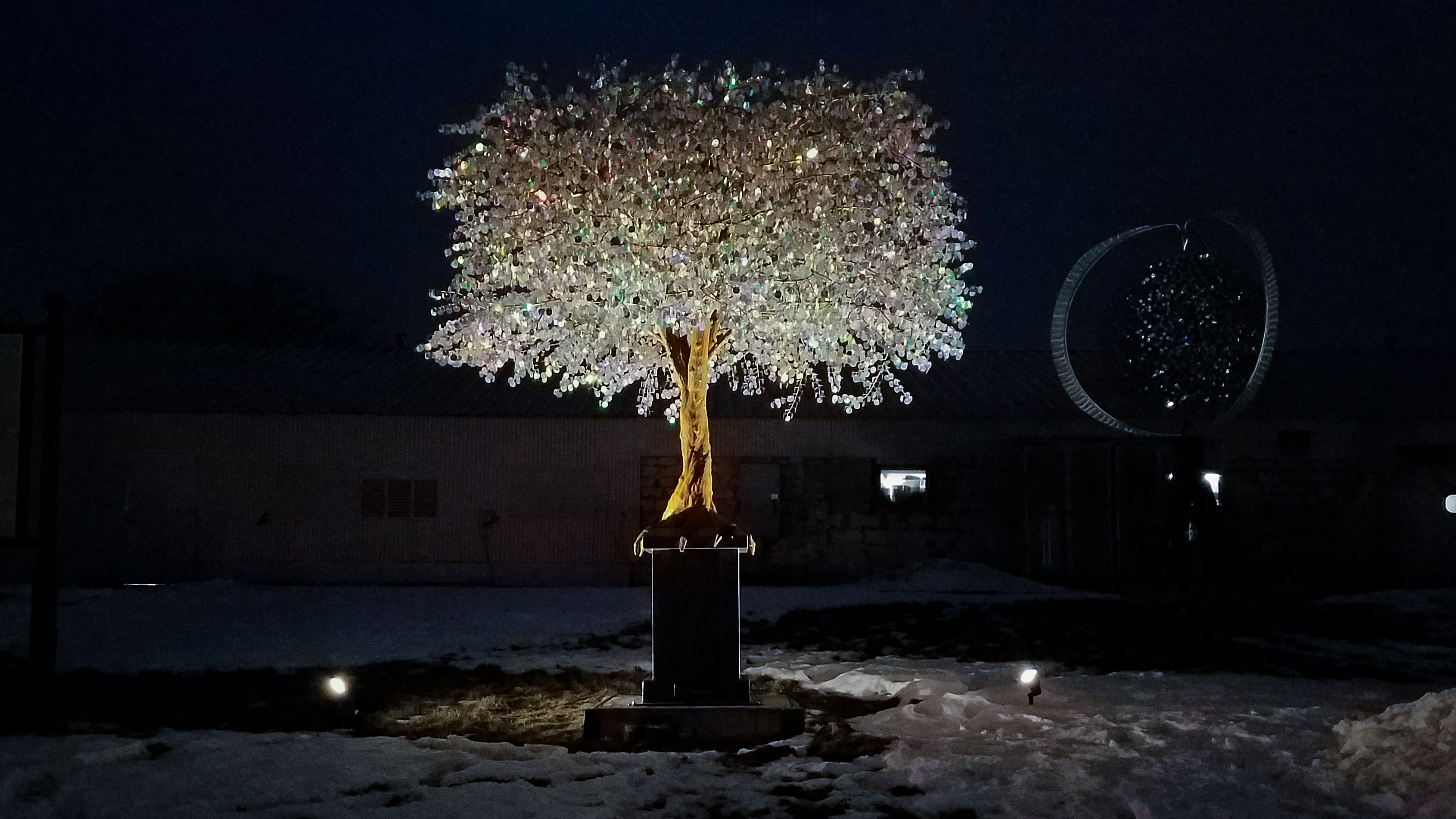<p>A 13-foot-custom-made tree lit up in front Ritchie Metal Works, December 20, 2017. (WLUK){&amp;nbsp;}</p><p></p>