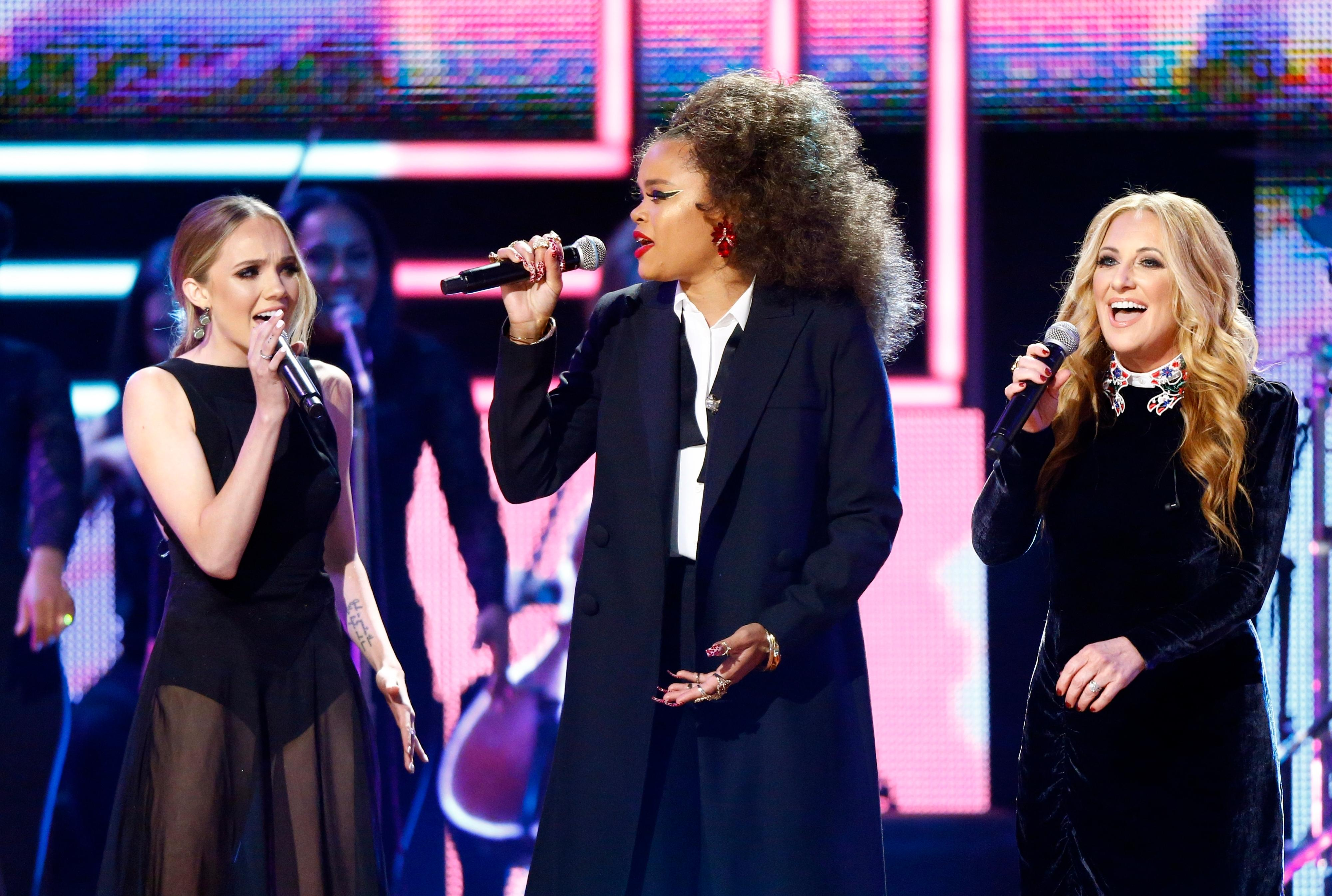 Andra Day, center, Lee Ann Womack, right and Danielle Bradbery perform at 2017 CMT Artist of the Year Awards at Nashville's Schermerhorn Symphony Center on Wednesday, Oct. 18, 2017, in Nashville, Tenn. (Photo by Wade Payne/Invision/AP)