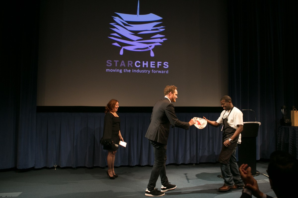 Edouardo Jordan of Salare accepting his Rising Star Chef from Will Blunt, Managing Editor of StarChefs, and Antoinette Bruno, CEO and Editor-in-Chief of StarChefs. (Image: Design StarChefs)