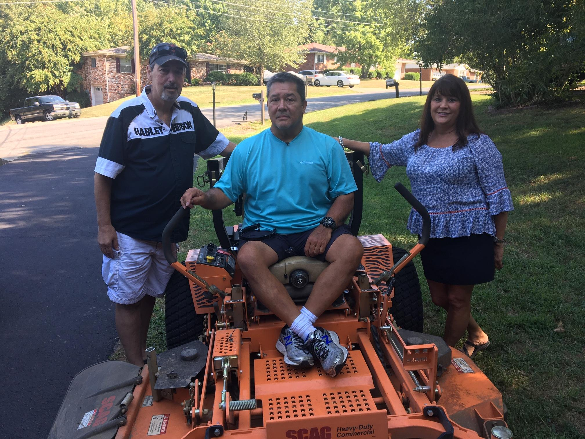 Chris Hays (pictured here between Scott and Annette Jackson) says he wants yard work not to be something his neighbors have to worry about. (Image: WTVC)<p></p><p></p>