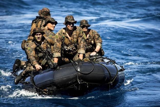 Marines approach the well deck of the amphibious assault ship USS Bonhomme Richard in a combat rubber raiding craft following a simulated boat assault to support a certification exercise in the Coral Sea, Aug. 8, 2013. The Richard is the flagship of the B