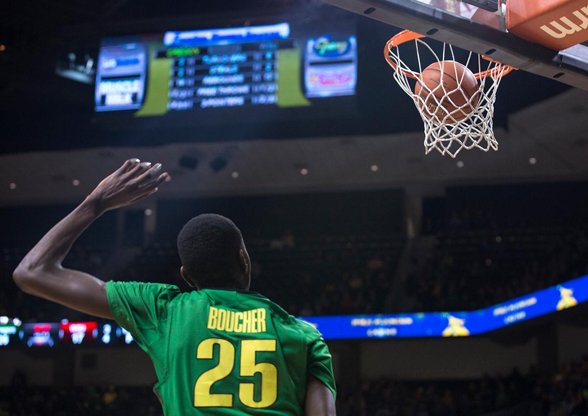 Oregon Ducks' Chris Boucher (#25) watches as his shot goes in during the game against the Washington State Cougars. Boucher played a double-double with 18 points and 13 rebounds.The Ducks beat the Cougars 76-62. Kianna Cabuco, Oregon News Lab