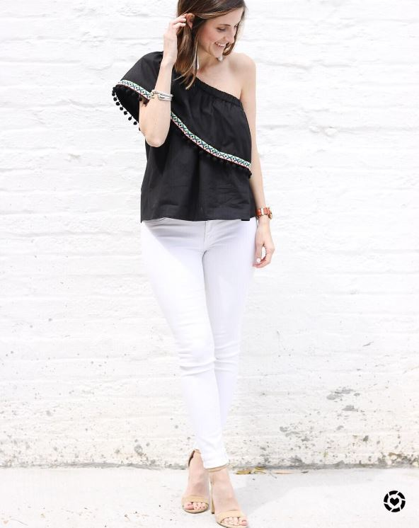 IMAGE: IG user @cobaltchronicles / POST: All smiles because it feels like summertime outside today! This fun pom pom top, tassel earrings, and white denim are all under $50!