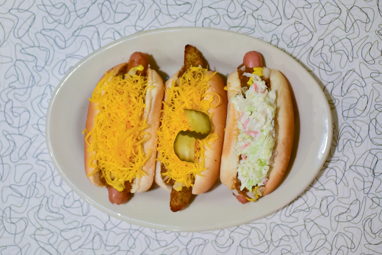 From left to right: Cheese Coney, The Lizard (fried pickle coney), and a Slaw Dog (cole slaw coney) / Image: Phil Armstrong, Cincinnati Refined // Published: 1.16.17