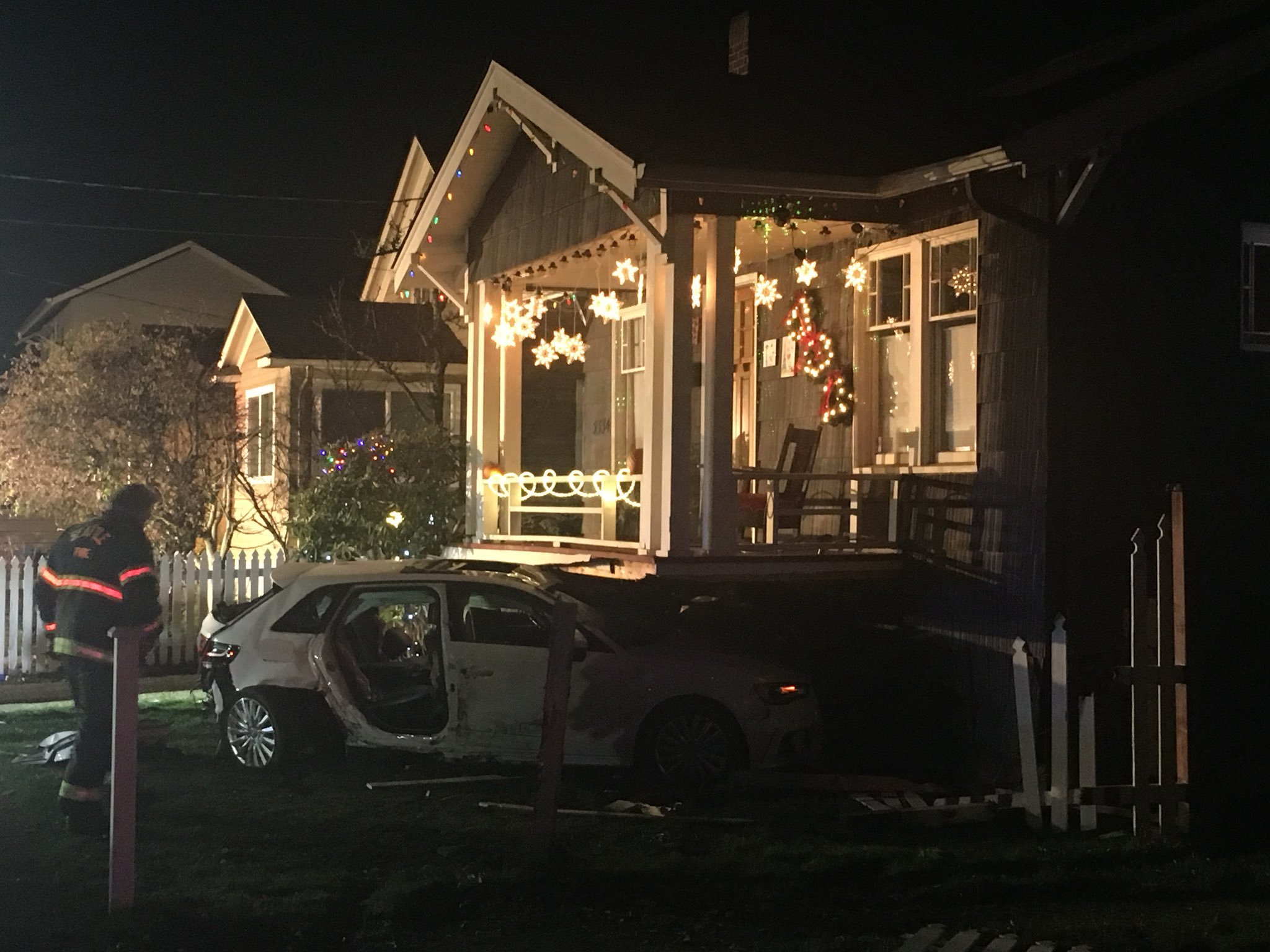 Emergency crews freed a driver trapped in a stolen car Monday night after it hit a natural gas line and smashed into a house in the University District.  (Photo: KOMO News/Air 4)