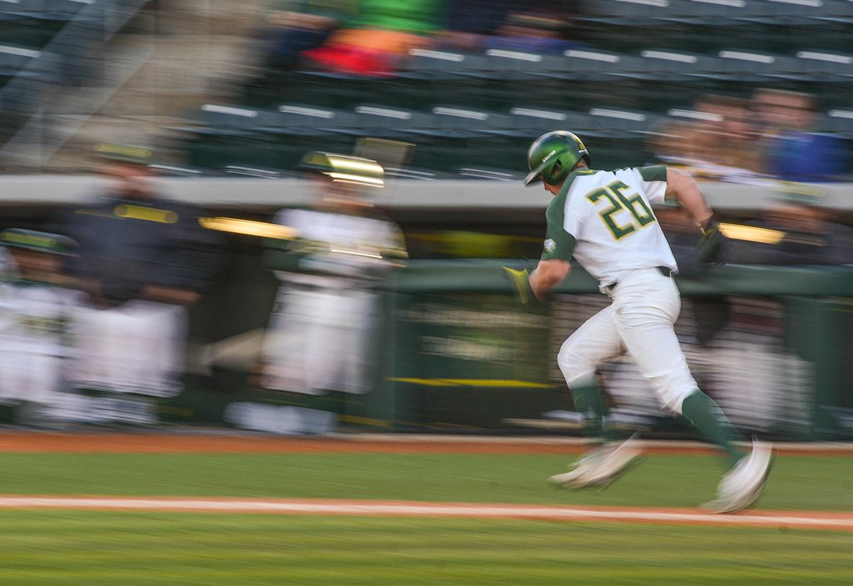 Ducks Daniel Patzlaff (#26) speeds down the first baseline to try and reach base safely. On Wednesday night the Ducks fell to the Loyola Marymount Lions 4-0 at PK Park. Photo by Jacob Smith, Oregon News Lab