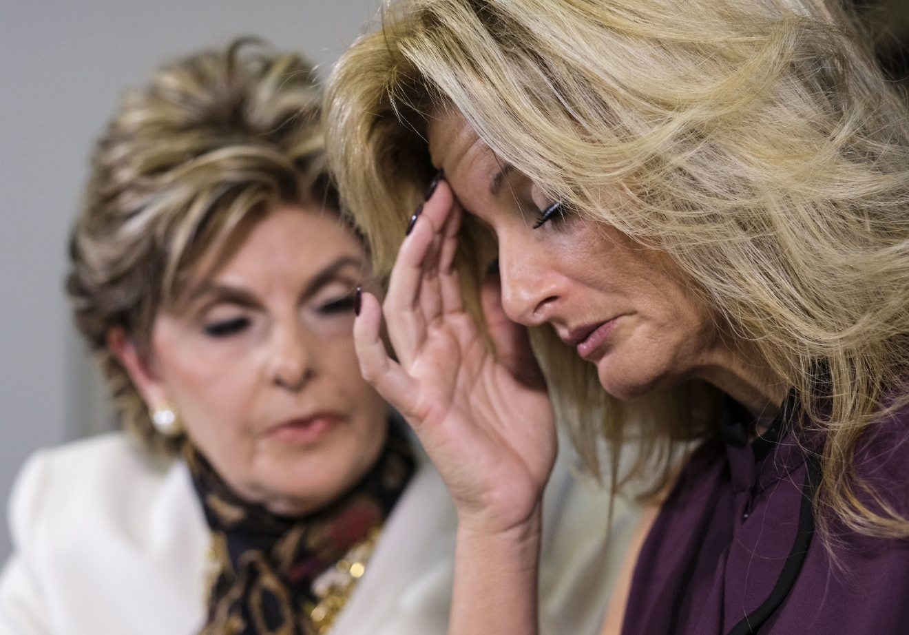 Summer Zervos, right, reads a statement alongside her attorney Gloria Allred during a news conference in Los Angeles, Friday Oct. 14, 2016. (AP Photo/Ringo H.W. Chiu)