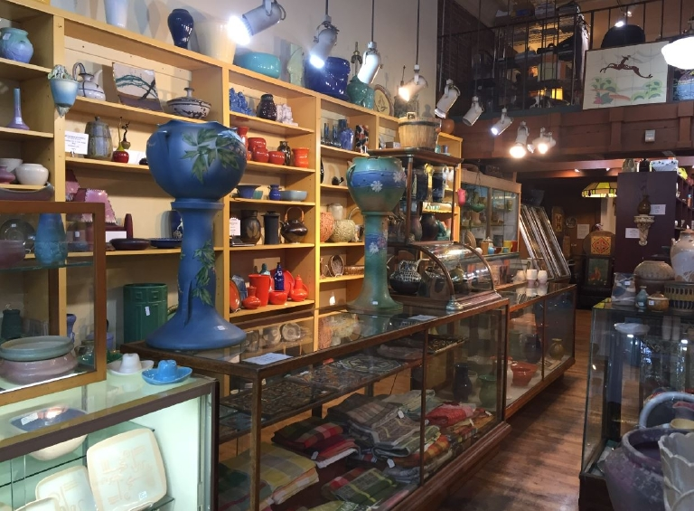 Nestled between the bars and boutiques of Pioneer Square, there's a unique shop with ties to the past. Laguna Pottery stocks pieces with a place (or should we say place setting) in history. (Image: Malia Karlinsky / Seattle Refined)