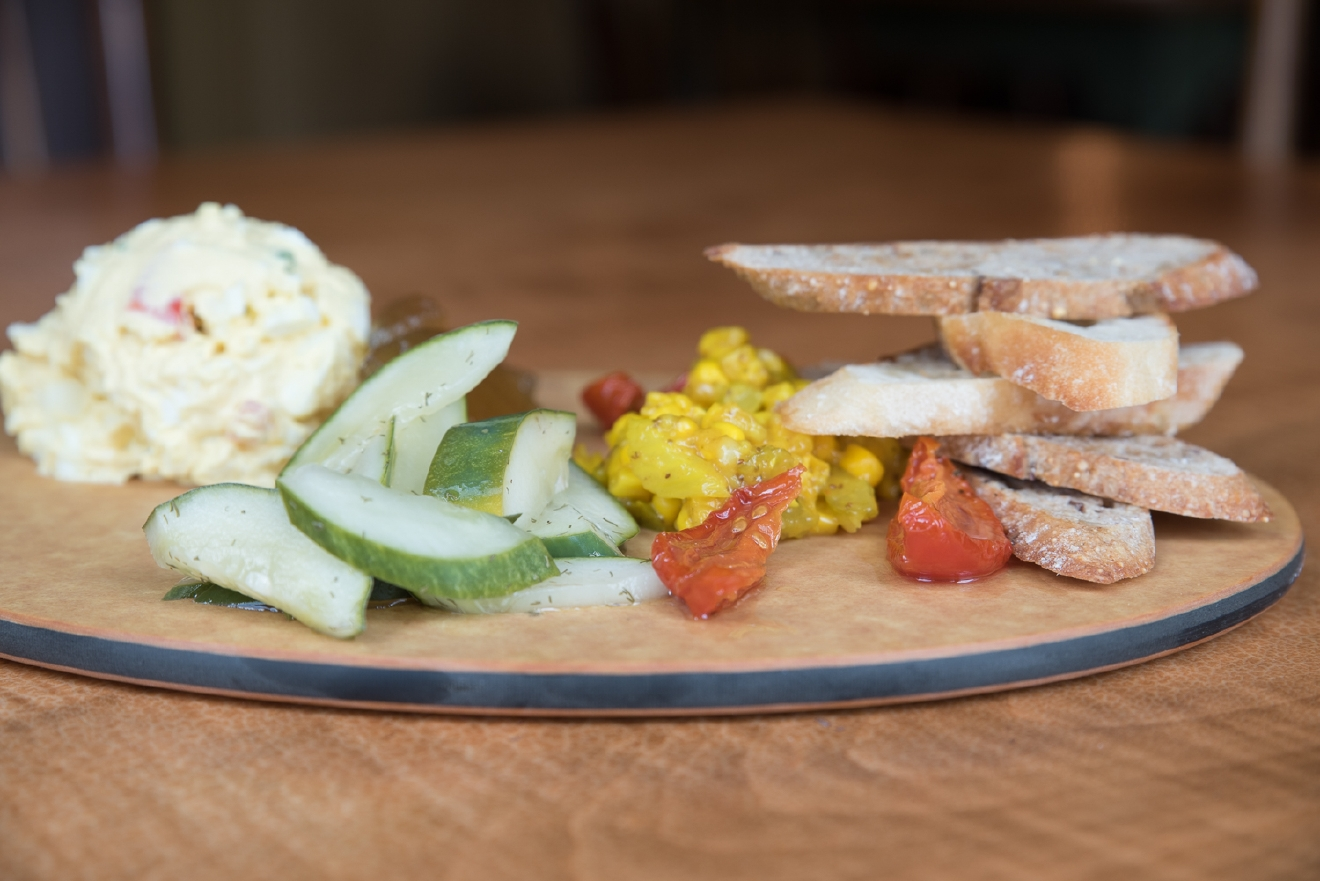 Relish platter (egg salad, pickled watermelon, corn relish, pickled local cucumbers, crostini & marinated tomatoes / Image: Sherry Lachelle Photography