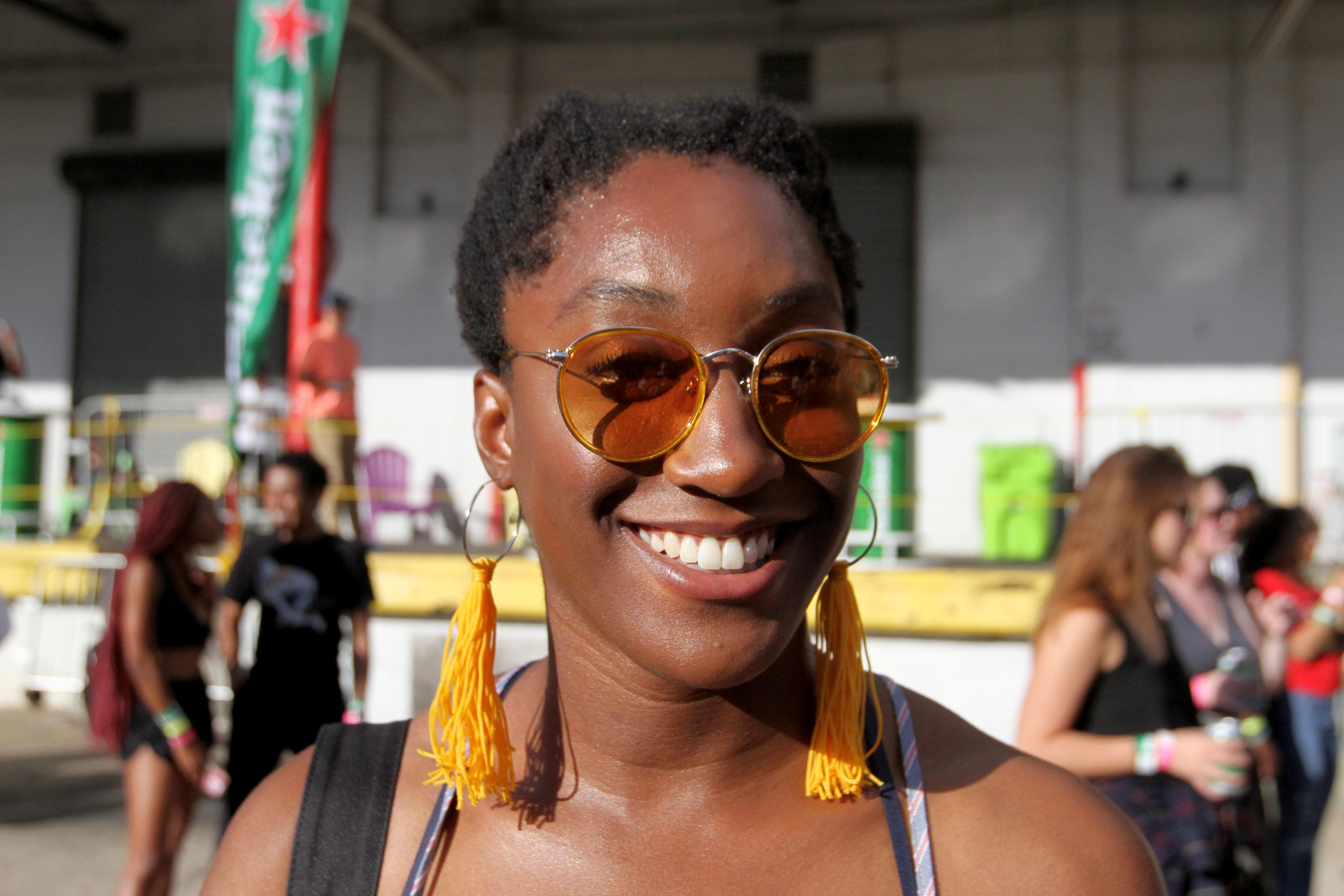 Millicent Osoro's coordinated sunglasses and earrings at All Things Go were super cute and unexpectedly retro. (Amanda Andrade-Rhoades/DC Refined)<p></p>