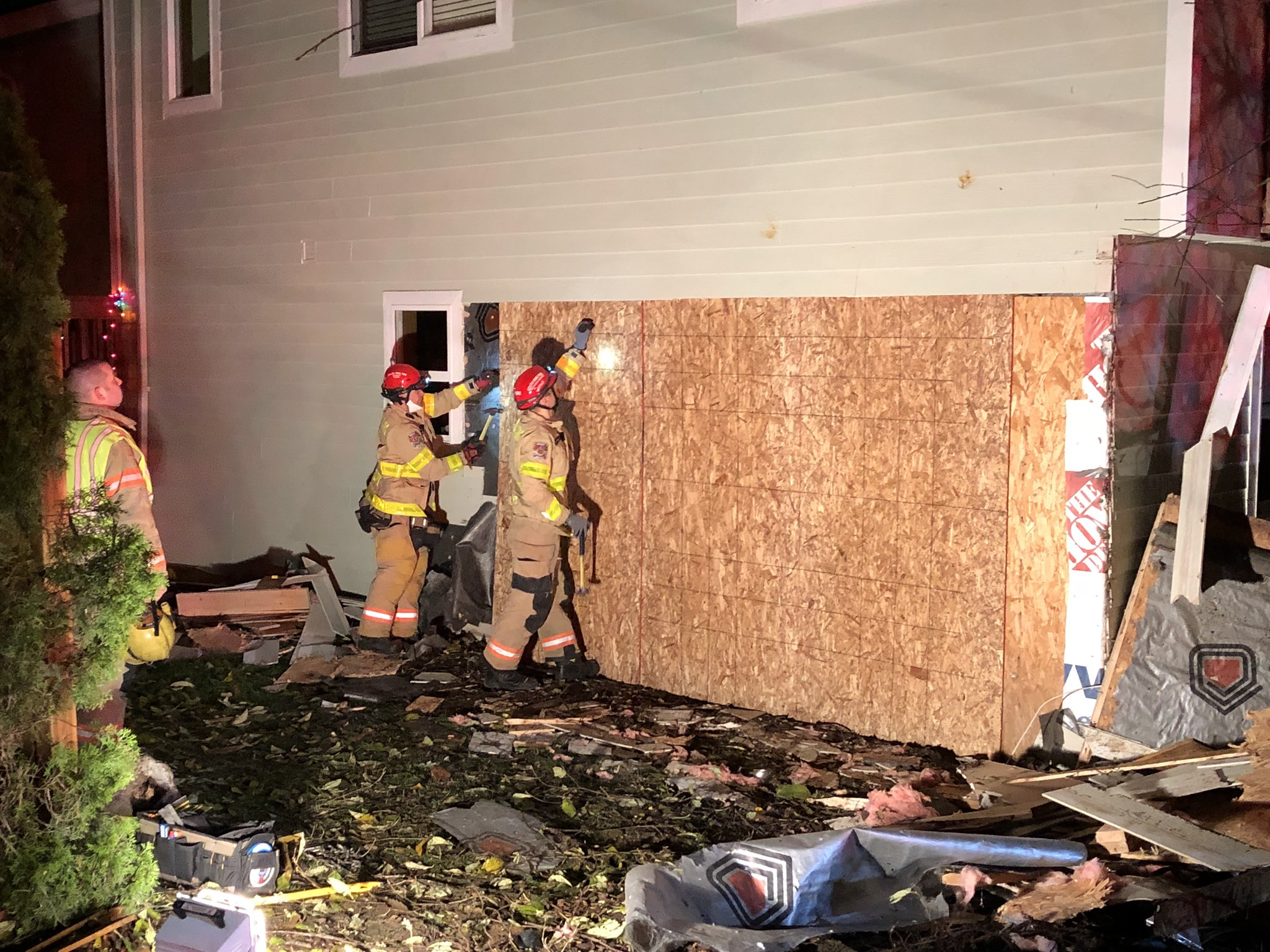 South King Fire and Rescue crews worked to patch up the house after a car drove through one of the walls early Friday morning. (Photo credit: South King Fire and Rescue)