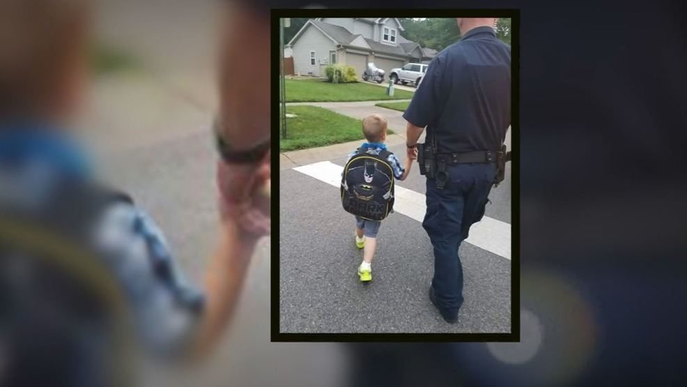 kid walked to school with cop.JPG