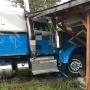 Semi-truck veers off Roy highway, crashes into home