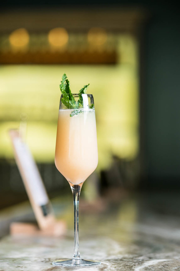 Bellini: fresh peach and prosecco topped with mint leaves / Image: Amy Elisabeth Spasoff // Published: 5.26.18
