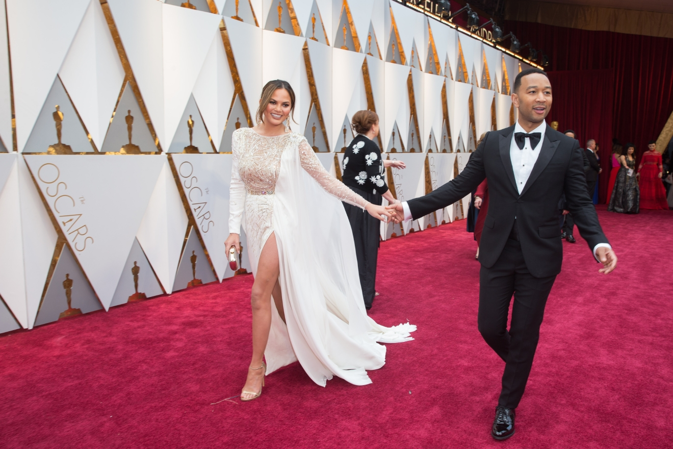 Chrissy Teigen and John Legend arrives on the red carpet of The 89th Oscars® at the Dolby® Theatre in Hollywood, CA on Sunday, February 26, 2017. (A.M.P.A.S.)
