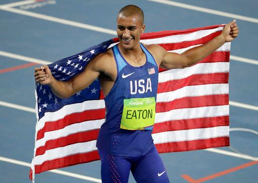United States' Ashton Eaton celebrates winning the gold medal in the men's decathlon during the athletics competitions of the 2016 Summer Olympics at the Olympic stadium in Rio de Janeiro, Brazil, Thursday, Aug. 18, 2016. (AP Photo/Julio Cortez)