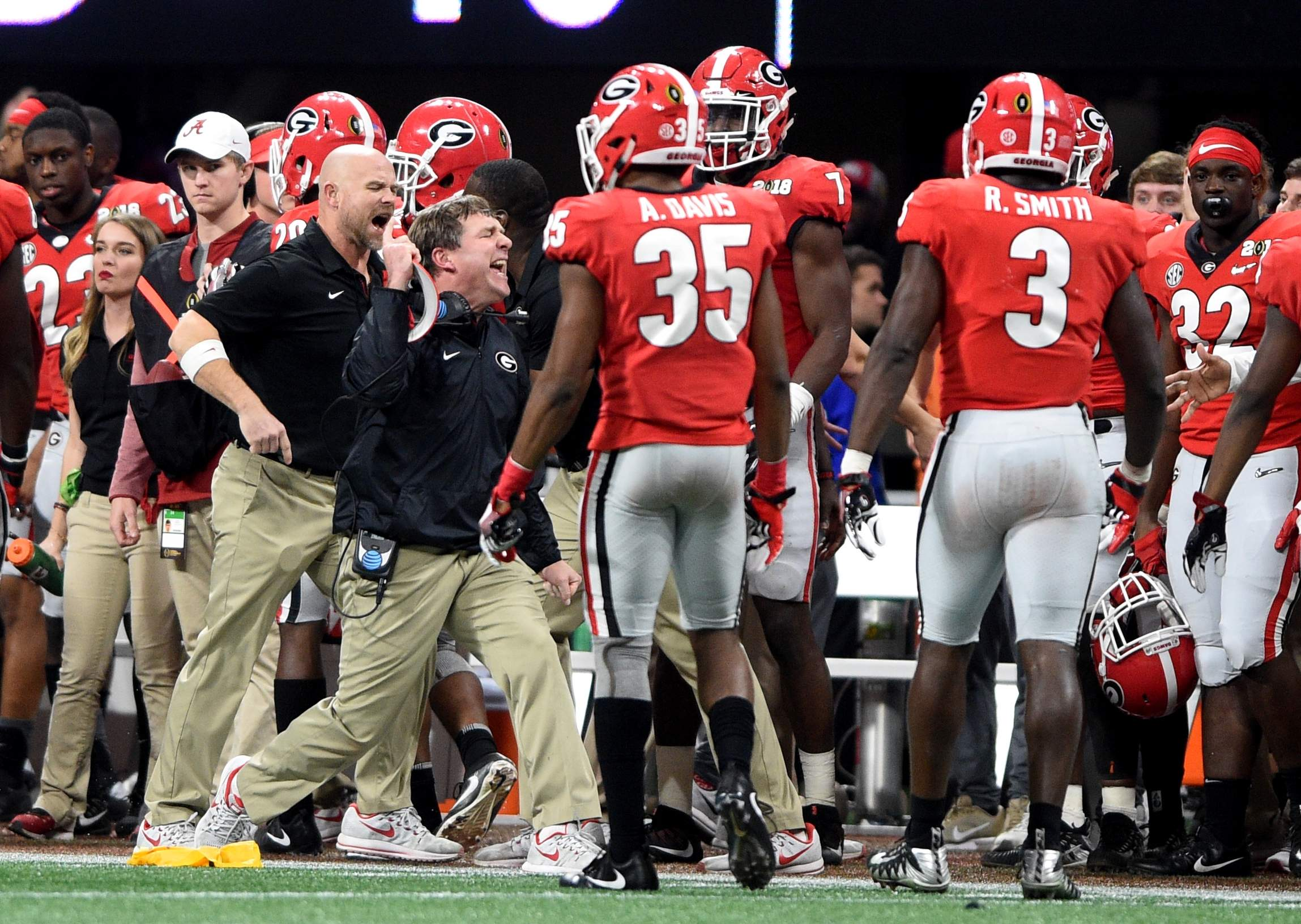 Georgia head coach Kirby Smart, middle left, yells at his players after the get a sideline infraction during the 2018 College Football Playoff National Championship at Mercedes-Benz Stadium in Atlanta, Ga., Monday afternoon January 8, 2018. MICHAEL HOLAHAN/AUGUSTA CHRONICLE