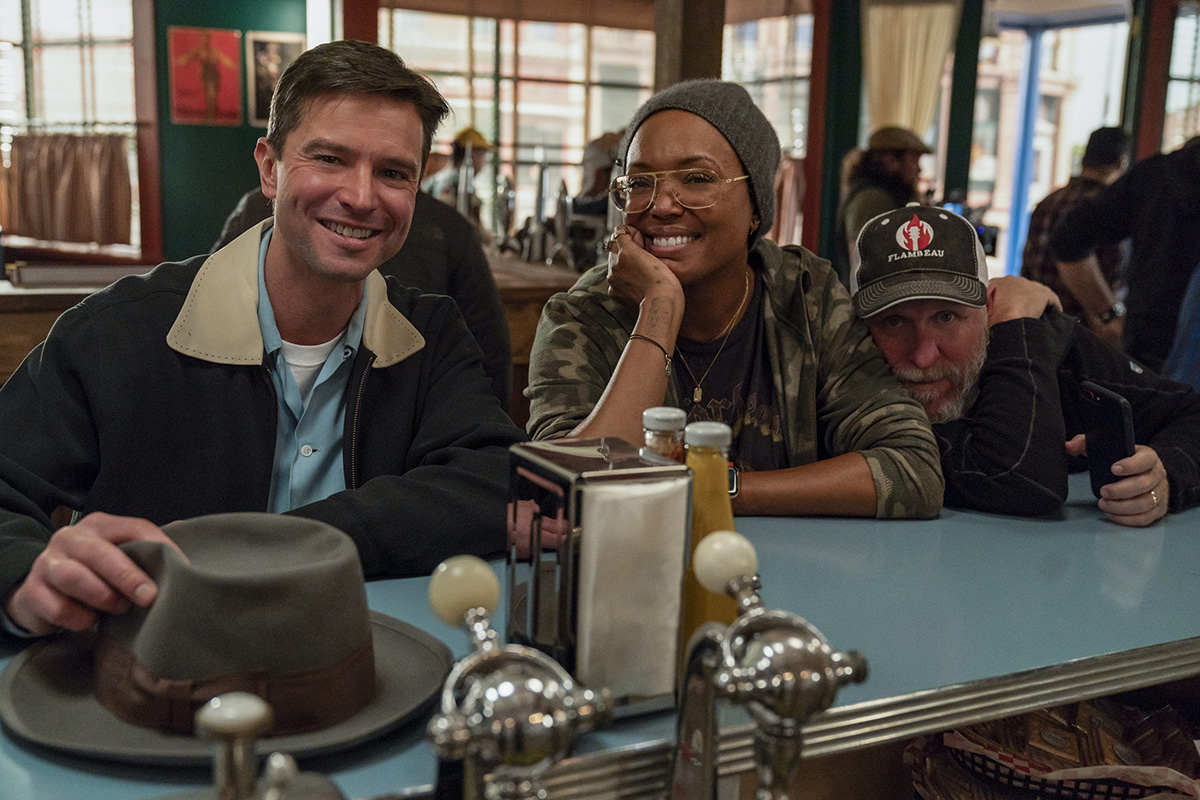 "Roswell, New Mexico -- ""The Diner"" -- Image Number: ROS209b_BTS_0639b.jpg -- Pictured (L-R): Behind the Scenes with  Jason Behr as Tripp and Director Aisha Tyler -- Photo: John Golden Britt/The CW -- © 2020 The CW Network, LLC. All rights reserved"