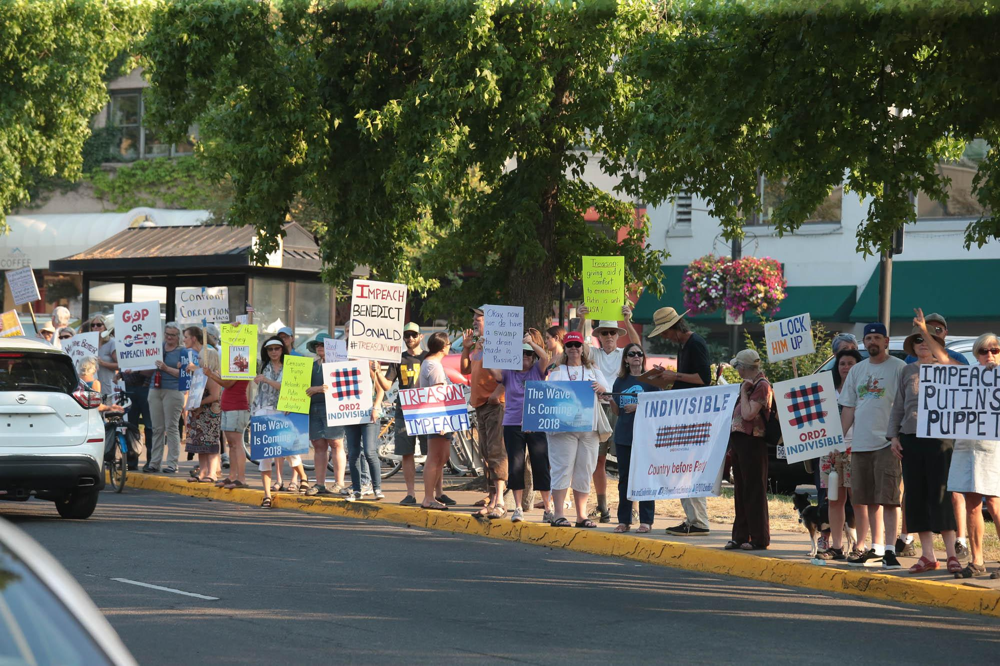 <p>Photo by Larry Stauth Jr.<br>Area residents gather Wednesday along Main Street in Ashland to protest President Donald Trump.</p>